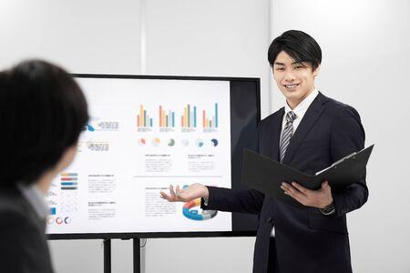 Japanese male businessman giving a presentation