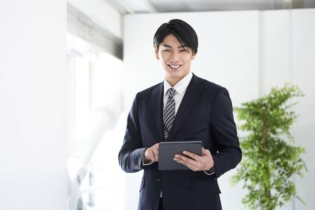 Japanese male businessman looking at the camera with a smile