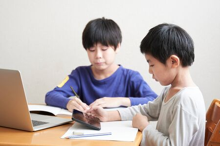 Japanese elementary school students studying online at home