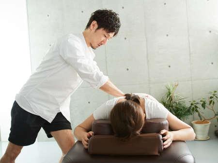 Japanese woman receiving hip massage