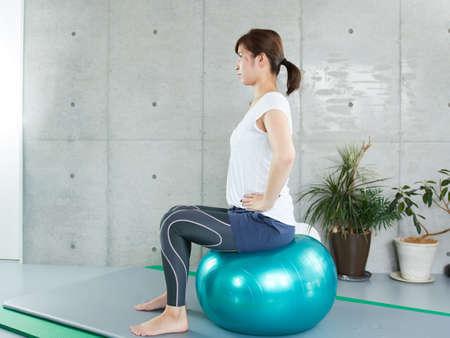 Japanese women doing self-training with balance balls