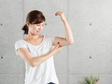A Japanese woman who worries about the sagging of two arms
