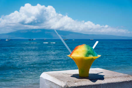 Shaved ice against the backdrop of the sea in Maui, Hawaii Stock Photo