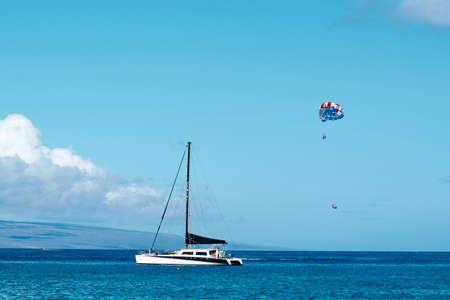 The image of parasailing at Ka'anapali Beach, Hawaii