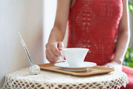 A woman relaxing over a cup of tea at an esthetic salon Archivio Fotografico