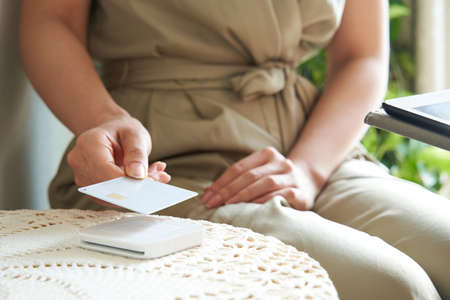 Japanese woman doing cashless payment at beauty salon