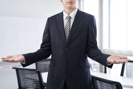 Japanese male businessman with open hands in the conference room
