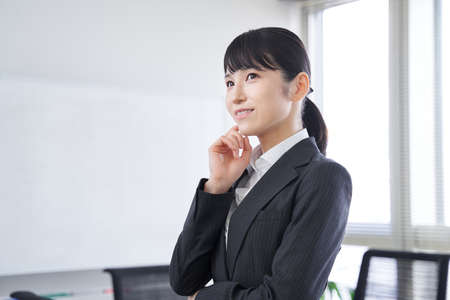 Japanese female businesswoman thinking in the office
