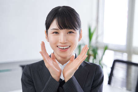 Japanese female businesswoman cheering in the office