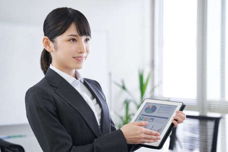 Japanese female businesswoman presenting at the office