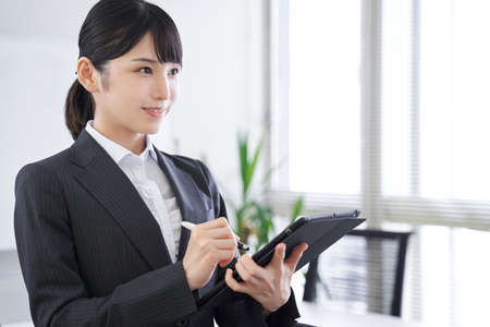 Japanese female businesswoman interviewing in the office Stock Photo