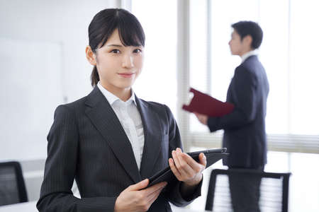 Japanese female businesswoman greeted with a smile in the office