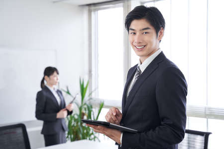 Japanese male businessmen greeted with smiles in the office