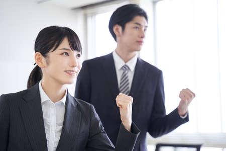Japanese business person who shows motivation toward the goal in the office Standard-Bild
