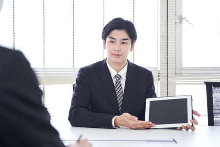 Japanese male businessman who does business in the office