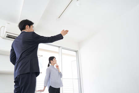 Japanese man real estate sales person who guides the house