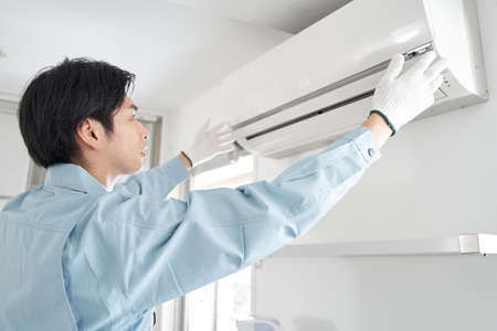 Japanese male electrical contractor who installs air conditioners for home use
