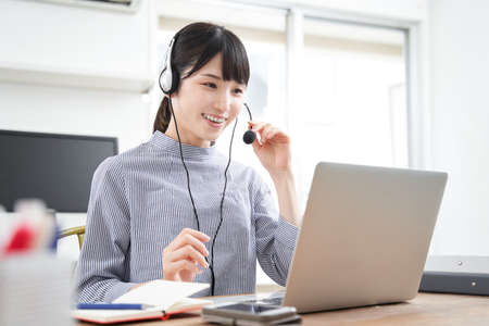 Japanese women businesswoman in plain clothes for online meetings at home