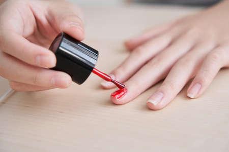 Japanese female junior high school student applying manicure