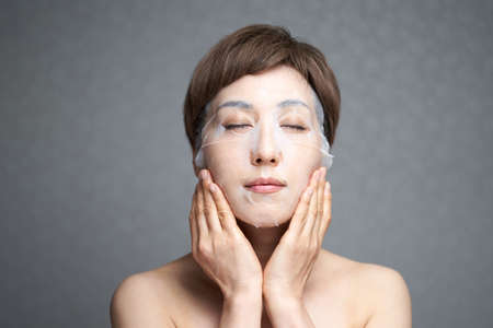 Middle-old Japanese woman playing pack