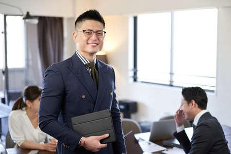 Smiling man at Asian and Latin English conversation meeting