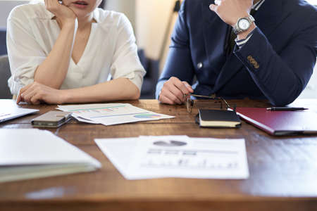 Asian business person stuck in business plan