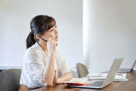 Asian woman suffering from telework