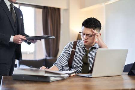 Asian businessman tired of being added work 版權商用圖片