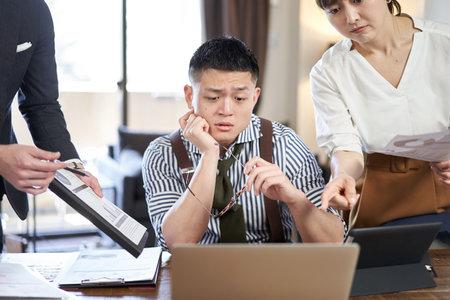 Asian male businessman chasing work and deadline Banco de Imagens