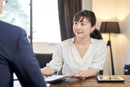Asian female businesswoman explaining