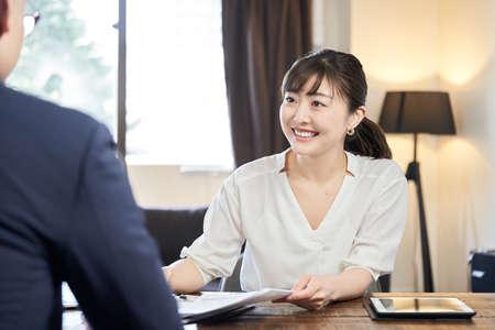 Asian female businesswoman explaining Archivio Fotografico