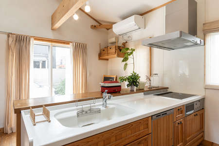 A kitchen in a house with impressive wood