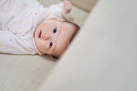 Asian girl baby in camera eyes