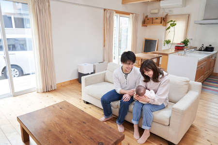 An Asian family of dads, moms and babies living in a single house