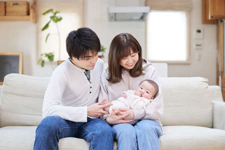 Asian family holding baby
