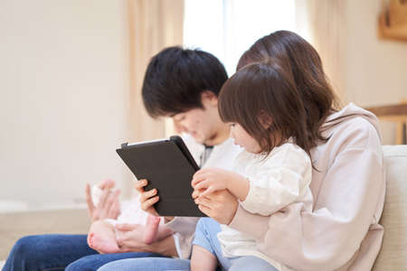 Asian girl looking at tablet