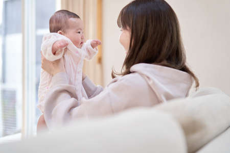 Asian mom holding baby
