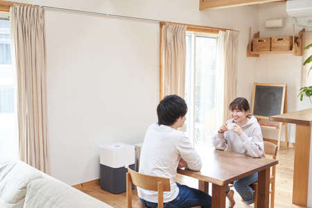 Asian couple having a conversation in the living room