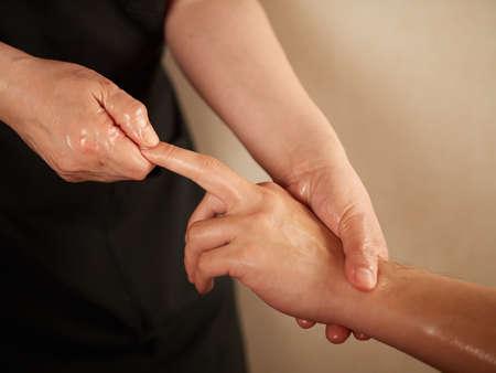 Asian man receiving finger massage Standard-Bild