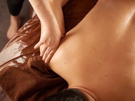 Asian man receiving arm and shoulder massage Standard-Bild
