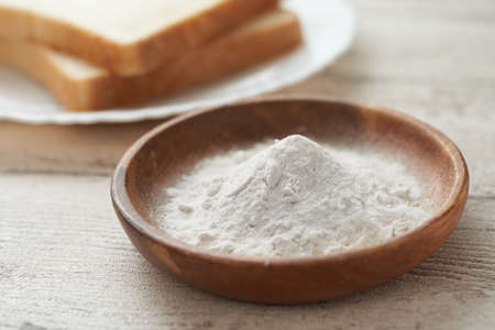 Flour and bread in a wooden bowl