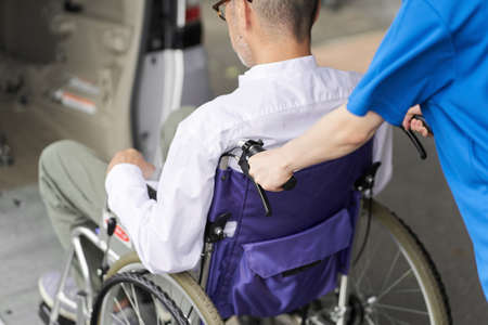 A caregiver who puts an elderly person in a long-term care taxi