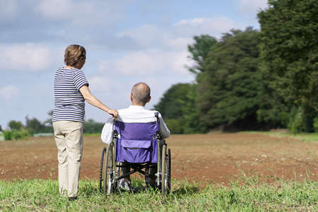 Elderly couple looking at the field