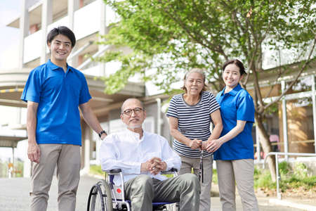 Wheelchair riding elderly and caregivers