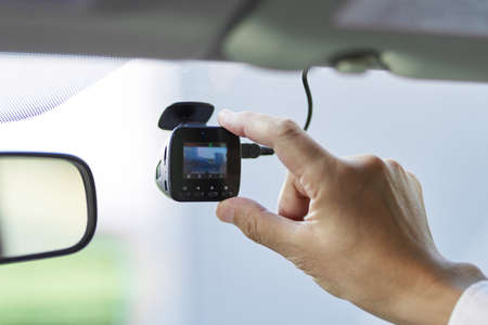 Male driver checking the drive recorder