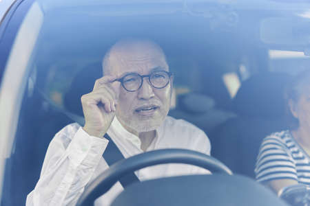 Elderly driver who cannot see the road sign well