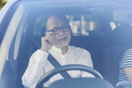 Elderly driver getting sleepy while driving