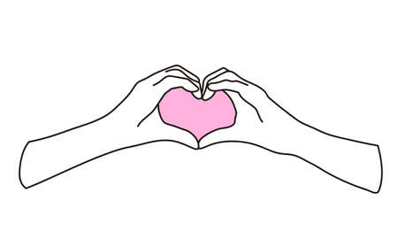 A woman's hand making a heart mark with her fingers