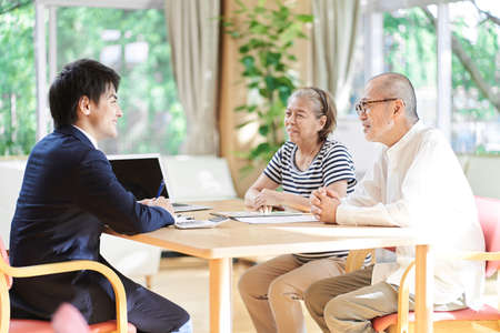 A businessman who advises an elderly couple on buying and selling real estate