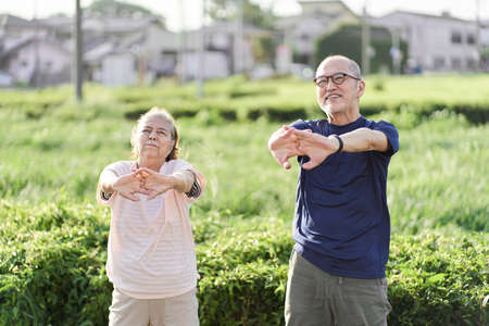 Elderly people doing preparatory exercises outside